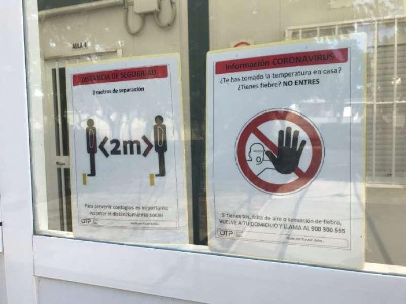 Cartells de precaucions al centre